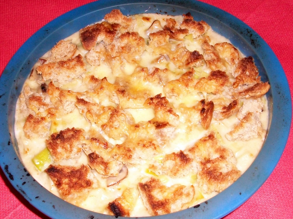 My offering- butter fried leaks and chestnut mushrooms in a pretty heavy cheese sauce with plenty of nutmeg, topped with more cheese and bread chunks then baked. I love this, and make it often and yes, it is absolutely worth the calories. Well received by my fellow foodies.